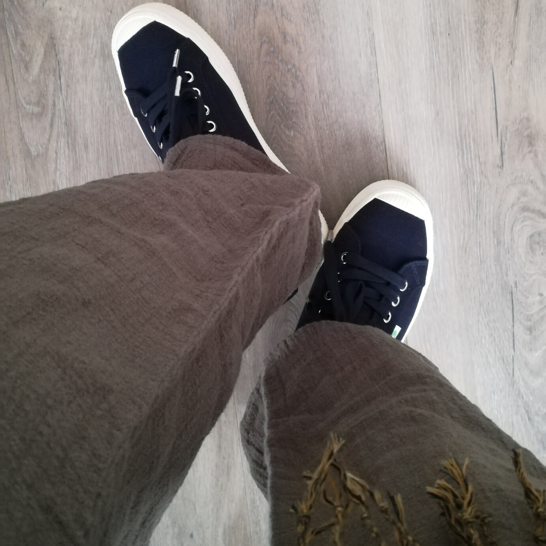 Tamanna showing off her Cariuma OCA Low Navy Canvas sneakers.