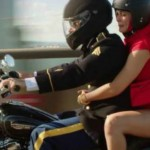 Image of a man and woman on a motorcycle.