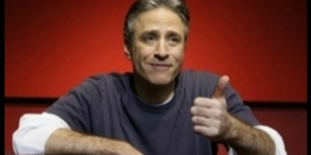 John Stewart giving a thumbs up
