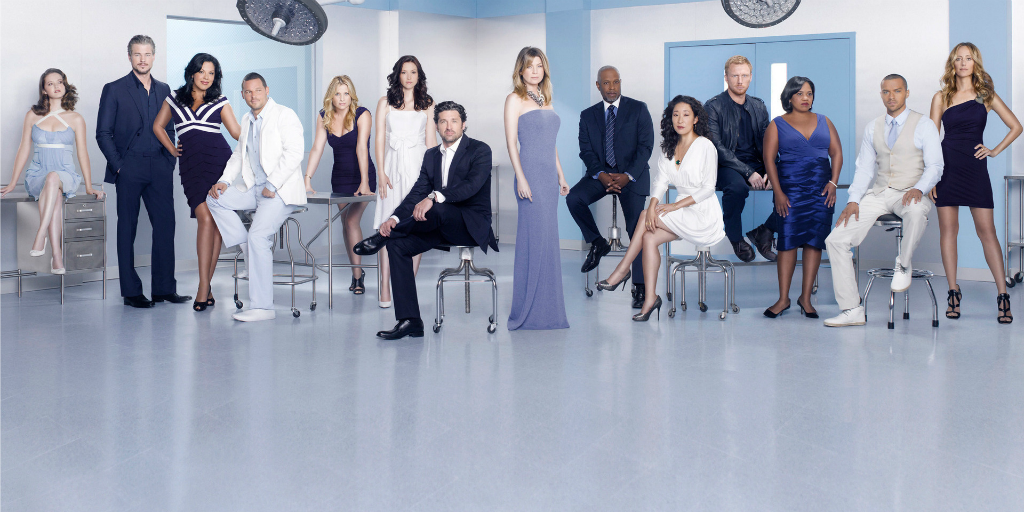 Grey's Anatomy cast in suits and dresses.