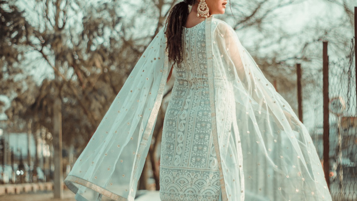 A woman in a white shalwar kameez on Eid.