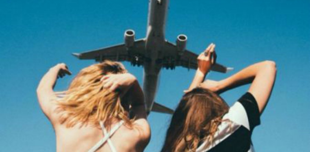 Girls Looking at Airplane
