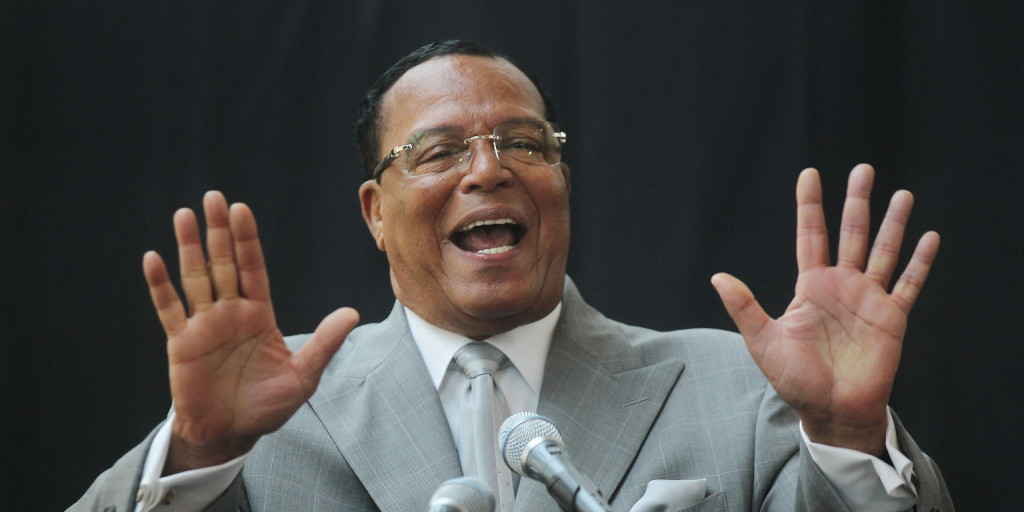 Louis Farrakhan puts his hands up.
