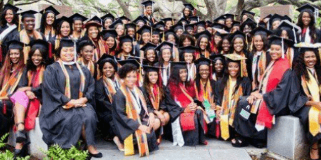 A group of women in graduation caps and gowns.