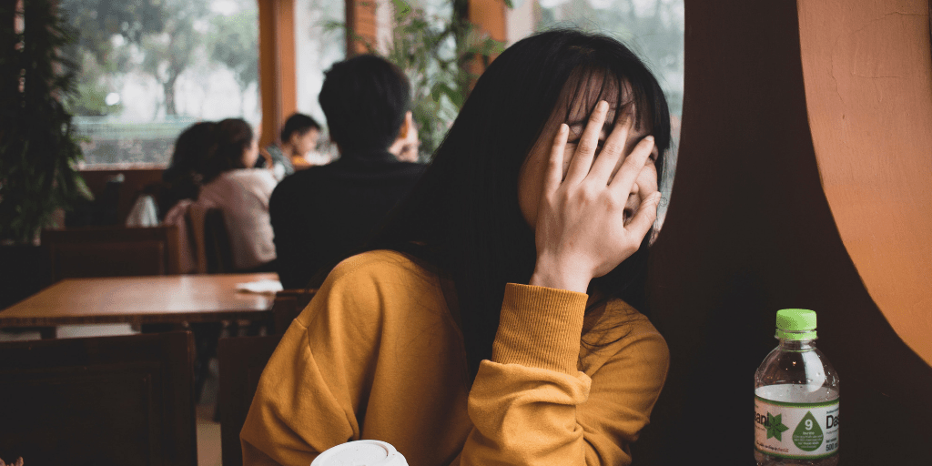 [Image description: Woman covers her face, embarrassed.] Photo by Pragyan Bezbaruah from Pexels