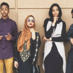 Six young black individuals wearing creative clothing.