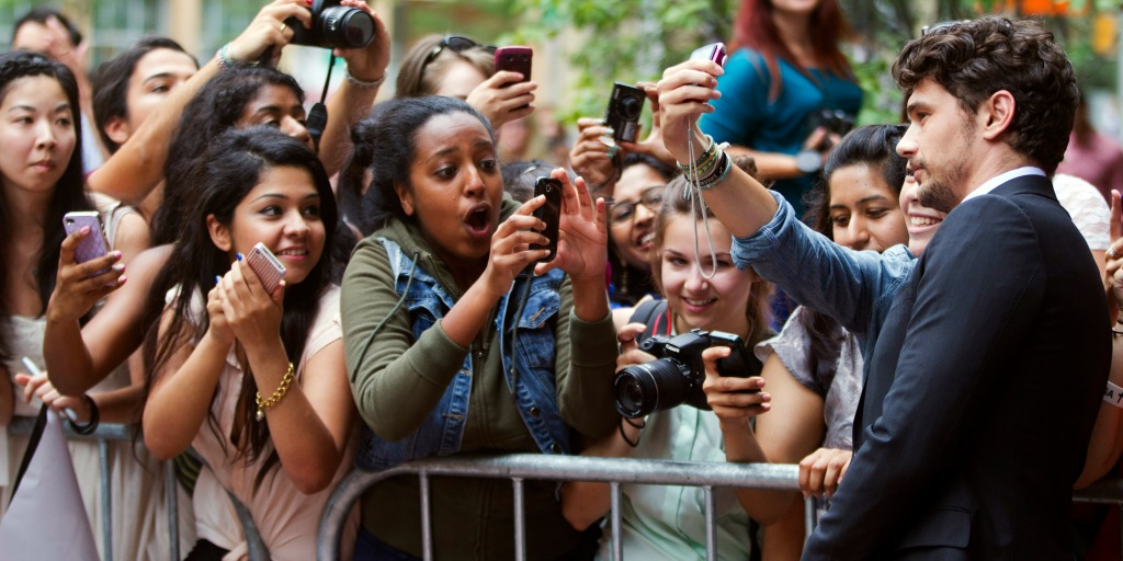 Fans greeting a celebrity