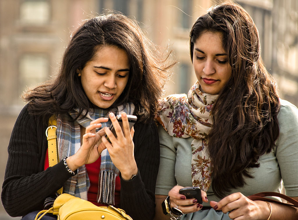 Friends looking at their phones