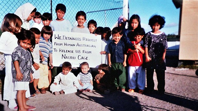 Children holding protest signs