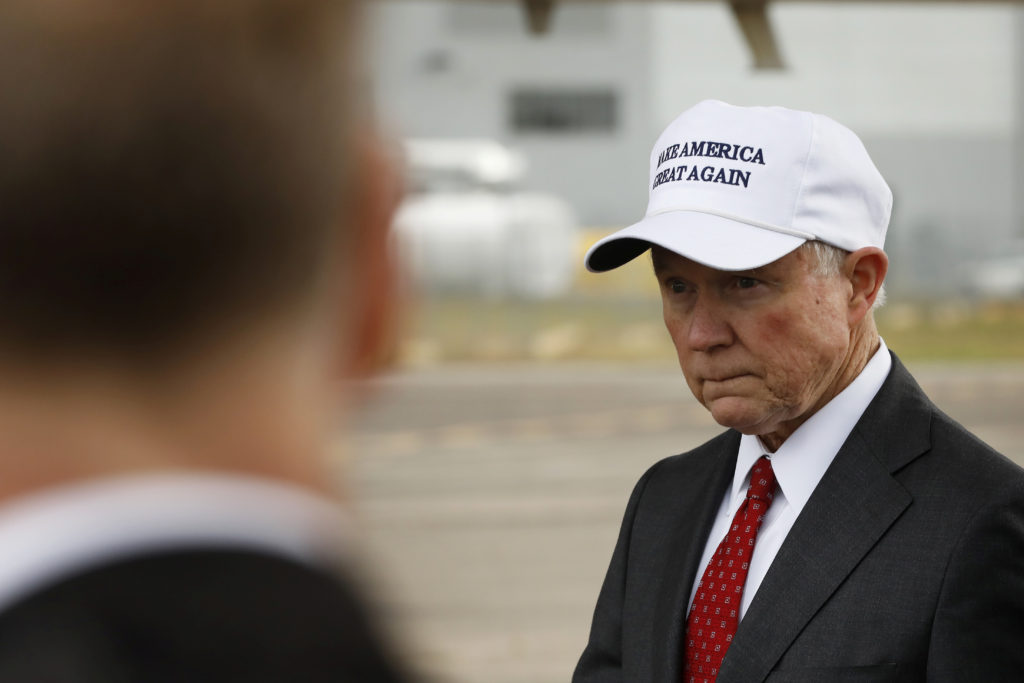 Senator Jeff Sessions (R-AL) waits for U.S. President-elect Donald Trump to exit his plane after arriving for stop on his USA Thank You Tour event in Mobile, Alabama, U.S., December 17, 2016.