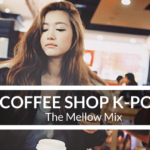 Asian girl in a coffee shop holding a go-to cup