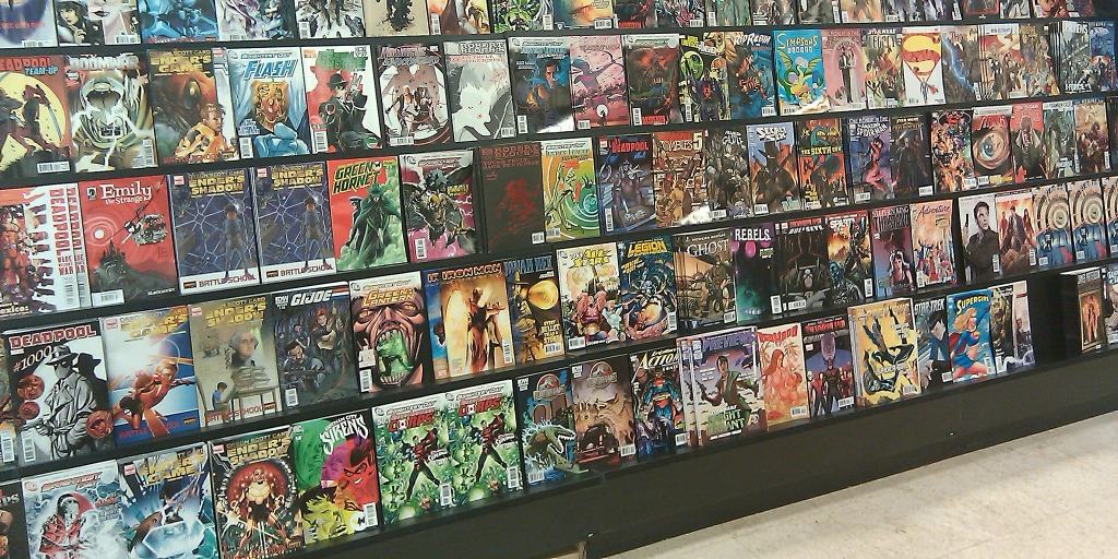 Image of a shelf of indie comics in a comic book shop