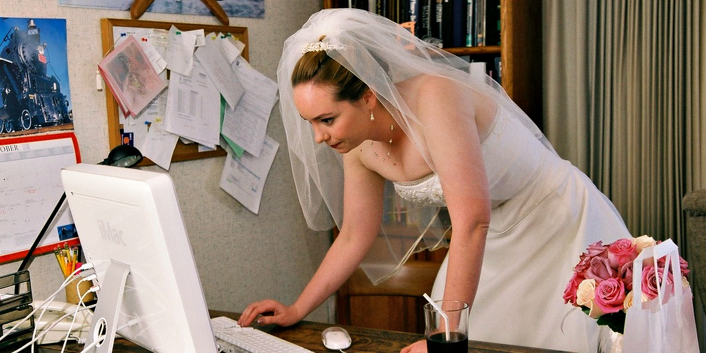Bride checking the computer