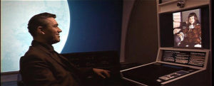 2001 A Space Odyssey, man placing video call to daughter