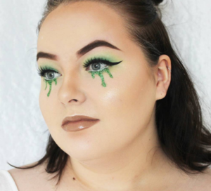 woman with green glitter tears