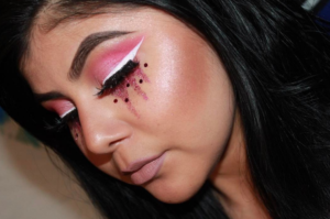 woman with pink glitter tears