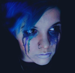 woman with blue and teal glitter tears