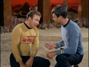 Dr McCoy preparing to use hypospray on Captain Kirk