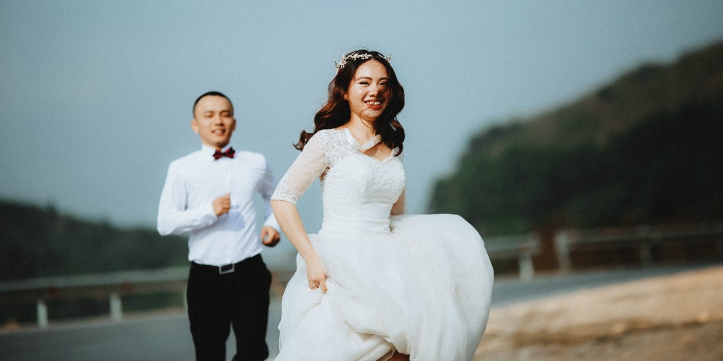 woman running away from man on their wedding day