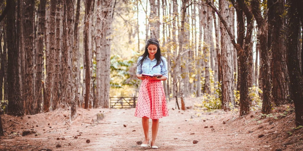 Girl reading in woods