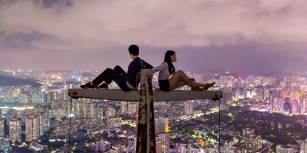 man and women in a relationship on a roof