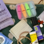 Picture of a mental health kit with items such as tea, pills, earplugs, and more