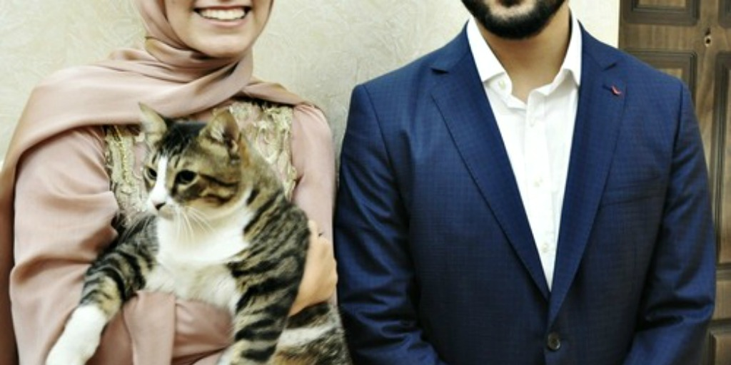 Muslim couple with cat