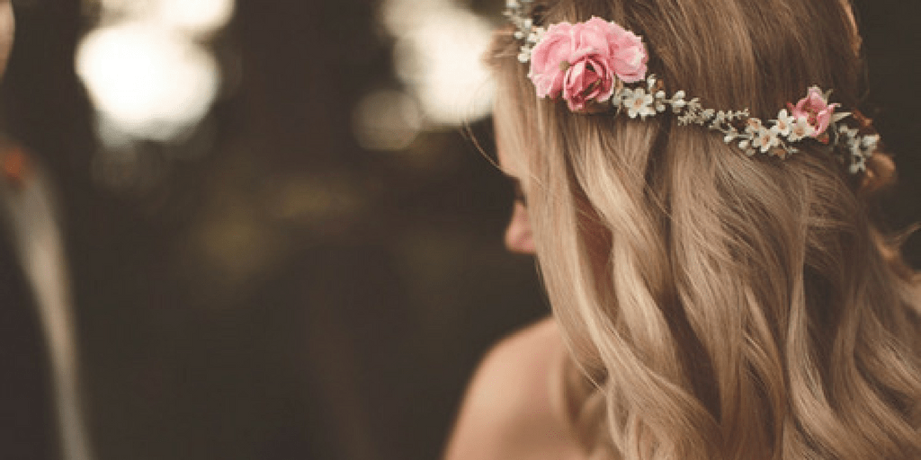 Light skinned blond woman wearing a flower crown