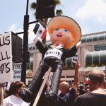 Source.comhttps://en.wikipedia.org/wiki/Timeline_of_protests_against_Donald_Trump#/media/File:Trump_protest_San_Diego_-_May_26,_2016.jpg