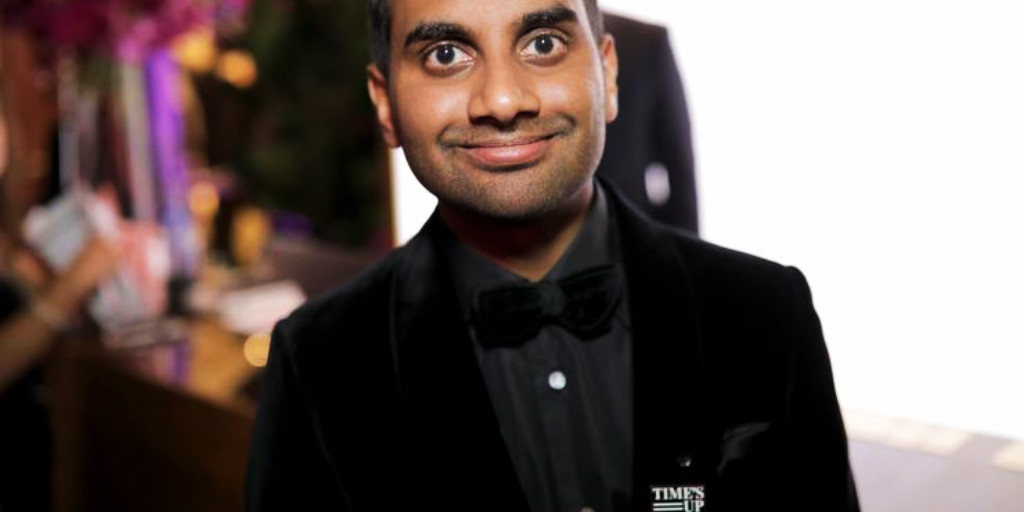 Aziz Ansari during the Golden Globes wearing a #TimesUp pin.