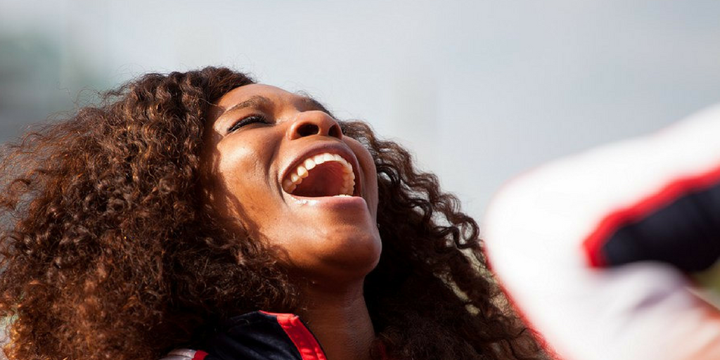 serena williams eyes closed, face to the sky with an expression of euphoria