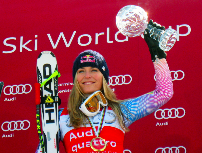 """[Image description: 2018 Olympic athlete and U.S. alpine skier Lindsey Vonn holding crystal globe in winning the Audi FIS Ski World Cup downhill title.] <a href =""""Flickr"""">Flickr.com </a>"""
