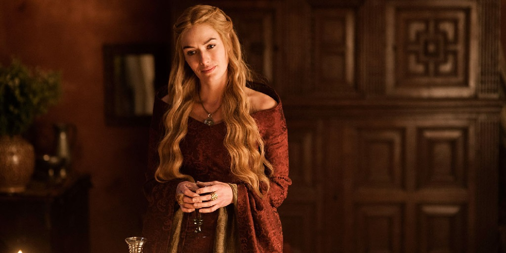 Attribution: [Image description: Cersei Lannister from Game of Thrones wearing a red dress with long, blonde hair. She has her hands together and is looking down, concerned.] Via Pinterest