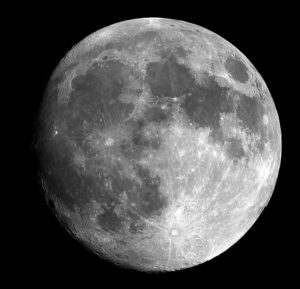Close up of the super moon which is huge and white on a black background