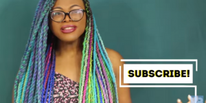 A black female youtuber with colorful braids.