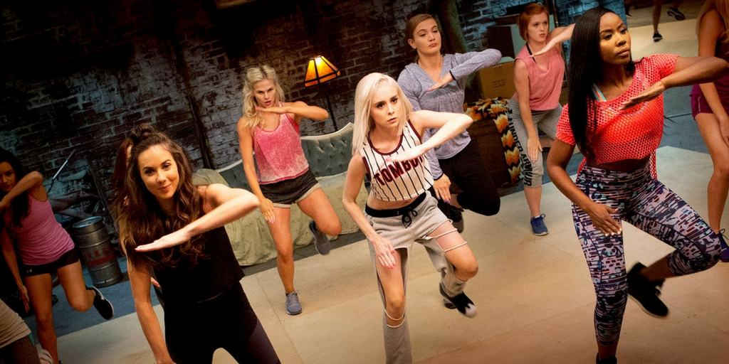 "A white sorority practices their step routine in the movie ""Step Sisters""."