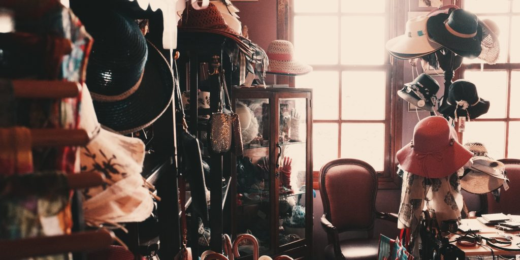 The interior of a thrift store, full of clothing and accessories.