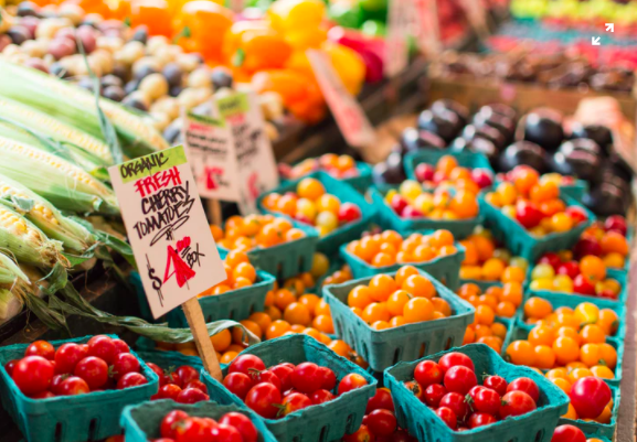 "[Image description: multicolored tomatoes and other produce at a farmers market]<a href=""source"">Unsplash.com </a>"