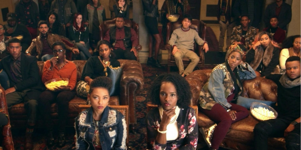 [Image description: The cast of Dear White People stares ahead in a still from the final episode of the first season.] Netflix.com