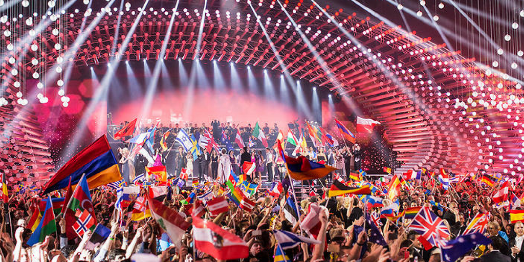 A view of the crowd holding up country flags during Eurovision 2018.