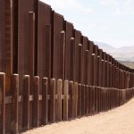 The view of the border wall for miles