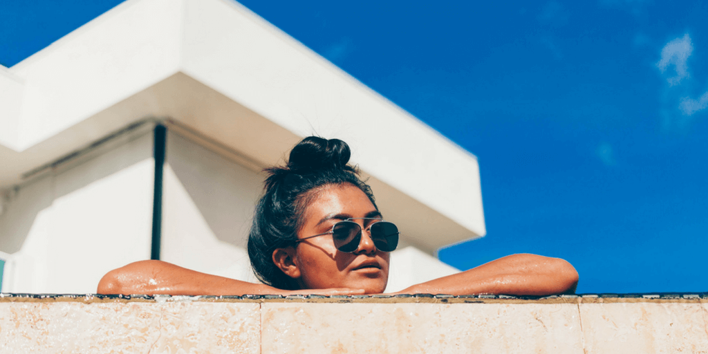 [Image Description: A woman lies tanning, via unsplash.com]