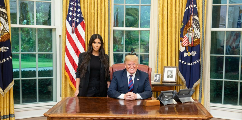 [Image Description: Donald Trump and Kim Kardashian pose for a photo during their meeting at the White House, via twitter.com]
