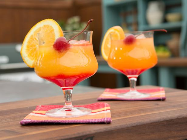 A photo of two tequila sunrise drinks.