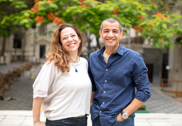 Image description: The founders of XPay, a man and woman are standing together smiling.