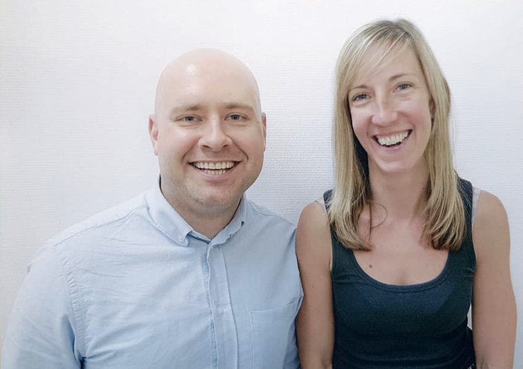 Image description: The founders of WeShareProperty, a man in a blue shirt and a woman in a dark tank top.