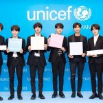 [Image Description: BTS are standing in front of a blue background that says UNICEF on it, holding slogans that say #BTSLoveMyself and #EndViolence. From left to right: V, Suga, Jin, Jungkook, RM, Jimin, J-Hope]