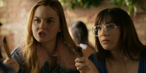 [Image Description: Banana Split's April and Clara threatening someone out of the frame with butter knives. They look serious, but they're joking!] Original Image via American Indie