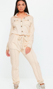 Image via Missguided [image description: a woman modeling an ivory jumpsuit from Missguided]