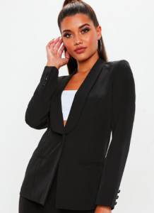 Image via Missguided [image description: a woman modeling a black blazer from Missguided]